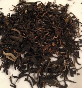 Dry, unsteeped leaves of the Hawaiian grown Aged Roasted Black Tea.